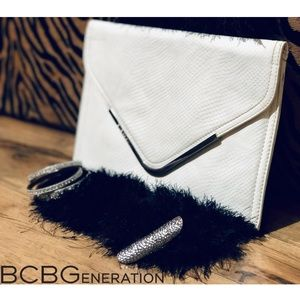 BCBGeneration Bags - 🚨SALE🚨BCBGeneration white faux snake skin clutch